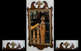 Antique Chippendale Mirror - in mahogany and gilt wood with a large winged eagle finial captured in