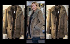 Ladies Genuine Sheepskin Coat three-quarter length, three button front with front pockets.