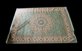A Large Woven Silk Carpet Keshan rug with green ground and with traditional floral and foliate