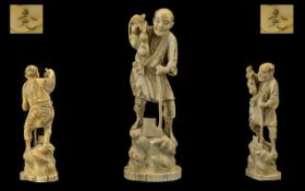 Japanese - 19th Century Signed and Well Carved Ivory Figure ' Wood Cutter ' Standing on a Large