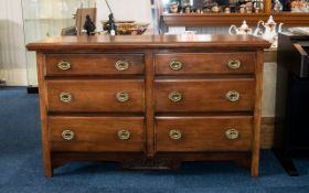 Early 20th Century Set of Drawers good solid construction. Six drawers tapering in height, scroll