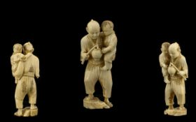 Japanese - Nice Quality Well Carved Ivory Figure of a Father and Son. Meiji Period 1864 - 1912.