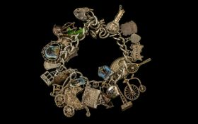 Chunky Silver Charm Bracelet with Many Silver Charms, Including A Pram, Holy Bible, Blackpool Tower,