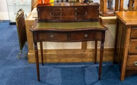 Ladies Writing Desk the upper section with three central drawers between two storage compartments.