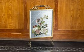 A Brass Fire Screen with hand painted mirror. Decorated with painted roses. Circa 1950s.