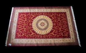 A Large Woven Silk Carpet Aubusson rug with red ground and with traditional floral and foliate