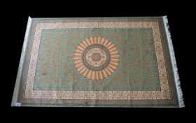 A Large Woven Silk Carpet Aubusson rug with green ground and with traditional floral and foliate