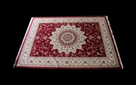 A Large Woven Silk Carpet Keshan rug with red ground and cream border with traditional floral and