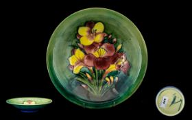 William Moorcroft Signed Tubelined Footed Bowl ' Freesia ' Design on Green Ground. c.1935.