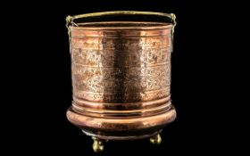 A Persian Copper And Brass Handled Bucket with geometric floral decoration throughout,