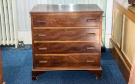 Traditional Victorian Chest of Drawers of plain form, four equal sized drawers with wooden handles.