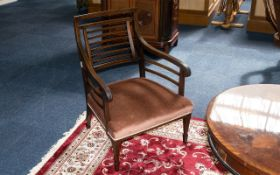 An Edwardian Inlaid Bedroom Chair in mahogany with inlaid banding throughout. Of wide proportions
