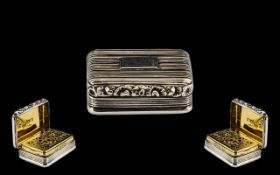 A George III Silver Vinaigrette of heavy form - fluted rectangular form, with a molded edge, gilt
