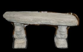 Timber Seat - A large straight timber seat on squirrel plinths.