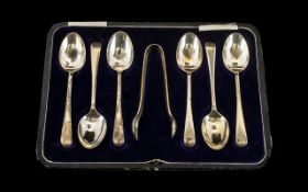 A Set of Six Boxed Silver Coffee Spoons and Nips of plain form. Hallmarked for Sheffield E - 1922.