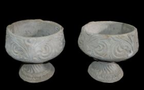 Two Acanthus Urns - two large acanthus urns decorated with acanthus leaves.