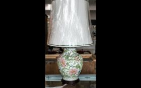 A Contemporary Oriental Ceramic Table Lamp Of baluster form, raised on shaped wooden base with
