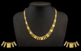 A Top Quality Made Ladies 9ct Polished Gold Necklace - of wonderful form and design. Hangs