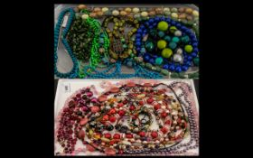 A Large Collection of Bead Necklaces in assorted colours. One collection in shades of pink, red