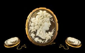 Early 20th Century Impressive 9ct Gold Mounted Cameo Brooch with safety chain, of oval form. The