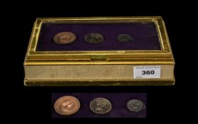 A Gilt Wooden Cigarette Box, the glazed hinged lid containing three coins all dated 1806