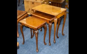 Nest of Three Tables With Glass Tops made in Maple wood veneer with carved edges and tapered feet.