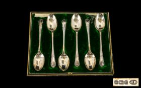 A Set of Six Boxed Silver Tea Spoons with plain bowls with stylised leaf terminals. Hallmarked for