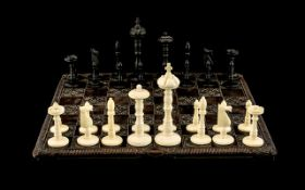 Early 20th Century Well Carved Ivory Bone Chess Set with Board. The Kings are 4.5 Inches - 11.25
