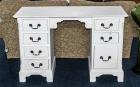 A Solid Pine Knee Hole Desk. 4 x 21 x 31 Inches High. Painted White Shabby Chic With Brass Handles.