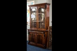 Late Victorian Mahogany Bureau Bookcase with a glazed top above a frieze drawer.
