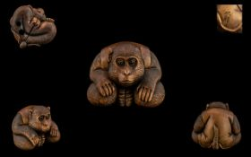 Japanese - Fine Quality and Signed Carved Boxwood Netsuke Meiji Period 1864 - 1912. A ' Crouching