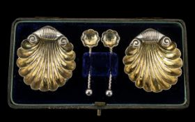 A Pair of Shell Formed Victorian Salts in fitted case with matching salt spoons. Hallmarked for