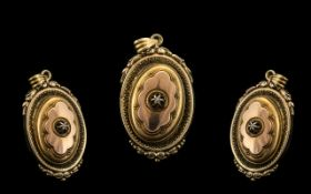 A Victorian Gilt Metal Hinged Locket with embossed oval locket, the hinged front with glazed