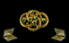 Victorian Period Attractive 15ct Gold Flower Brooch Set with Emeralds circa 1860.