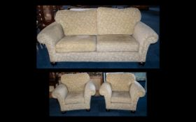Three Piece Suite comprising a three-seater sofa and two armchairs,