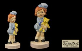 Carlton Ware - Lucie Attwell Handpainted Ceramic Figure Little Girl in Blue Dress holding a yellow