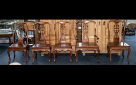 A Set of Five Hardwood Chinese Chairs comprising of 4 stand chairs and 1 carver.