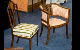 Two Edwardian Inlaid Chairs to include a tub chair with a padded seat and sides,