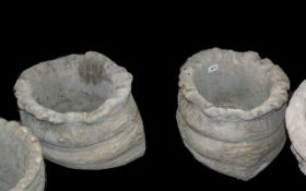 Sack Planters - Two large sack shaped planters.