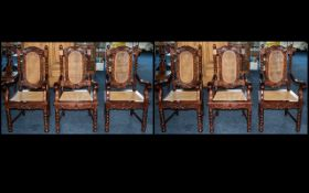A Set of Six Modern Mahogany Carver Chairs with rush seats and backs and barley twist supports.