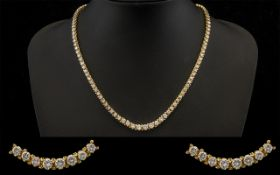 14ct Gold Superb Quality Stunning Graduated Diamond Set Necklace of Good Sparkle.