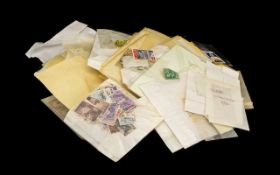 Large Bag of Mixed Stamps - sorted into packets.
