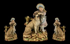 A German Heubach Late 19thC Bisque Figure Group depicting a baby piano girl with a large dog.
