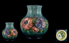 Moorcroft - Contemporary Designed Tube lined Globular Shaped Vase ' Anemone ' Design on a Blue