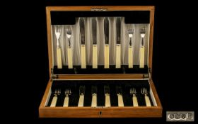 A Fine Boxed Set of Fish Knives and Forks, with Silver Blades and Prongs,