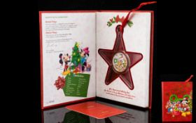 Disney Christmas Decoration Limited Edition 1/2 oz Silver Coin in red collector's book. 999 Fine