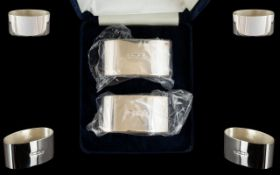 Elizabeth II Pair of Contemporary Sterling Silver Napkin Holders,