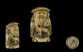 Oriental Carved Netsuke depicting a figural Scholar. Approx 2.5 inches in height.