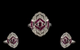 18ct White Gold Attractive Ruby and Diamond Set Dress Ring. Fully Hallmarked for 18ct.
