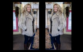 Ladies Fox Fur Coat with leather tie belt and trim, in pale beige colour, with shawl collar and hook